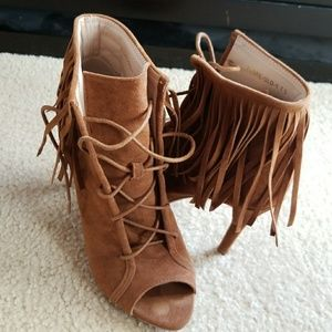 Peep toe booties with fringe details
